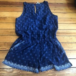 Blue Printed Sleeveless Romper With Pockets
